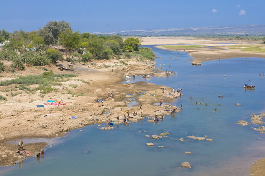 People washing clothes in the Mandrare River near the Berenty Private Reserve, Madagascar