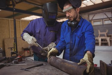 Men working together on a metal work