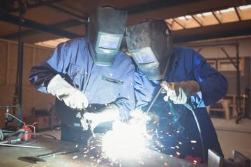 Welders welding a metal