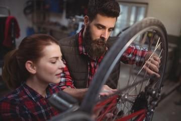 Mechanics repairing a bicycle