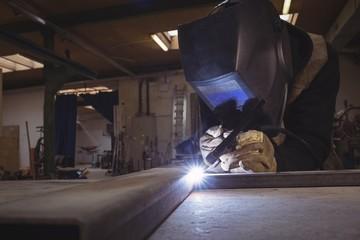 Welder welding a metal