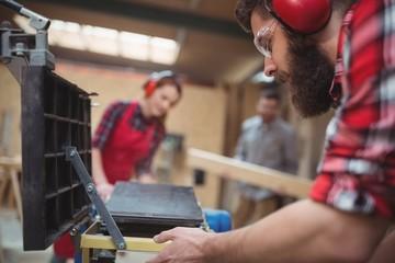 Carpenter using machinery