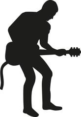 Guitar playing man silhouette