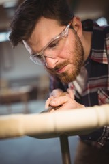 Carpenter working on a machine