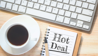 Concept Hot Deal message on book. A pencil and a glass coffee table.Vintage tone.