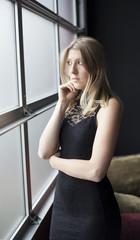 Blond Woman in Sexy Black Dress