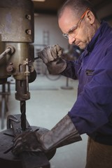 Tradesman working with machine