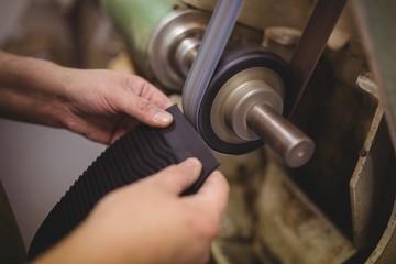 Close-up view of a cobbler preparing a sole