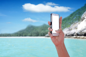 White screen showing on the smartphone with tropical island background.