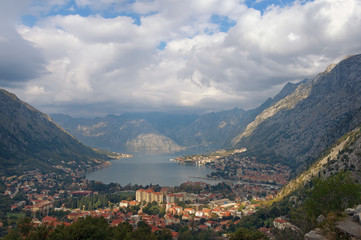 Autumn in Montenegro. View of Kotor city. Rays of light through the clouds