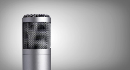 Vintage microphone on gray background