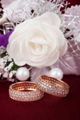 Wedding background with two rings and rose