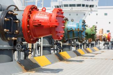 Cargo manifold of oil tanker.