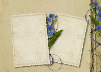 Grunge paper background with old card and flowers