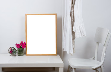 Empty wooden picture frame on the table, art print mock-up