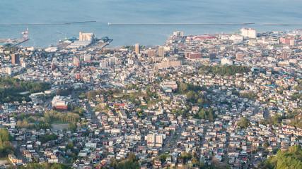 Aerial view of Otaru city in the evening, View from mount tengu Otaru, Hokkaido, Japan