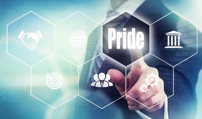 Businessman pushing a pride concept button.