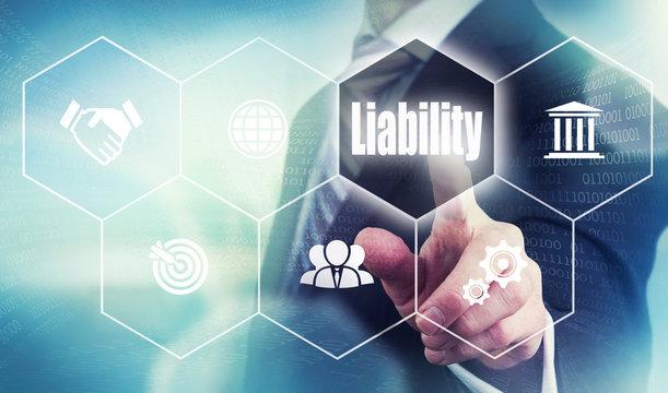 Businessman pushing a liability concept button.
