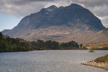 Scotland. Highlands. May 2016. A landscape format photograph of the dark foreboding mountain  that is Liathach from across  Loch Clair. Liathach situated in Glen Torridon in the Scottish Highlands