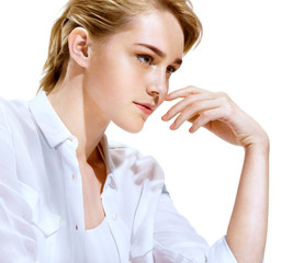 Beautiful blonde girl in profile on white background. Close-up, youth and skin care concept