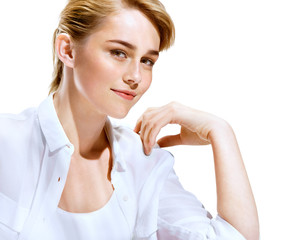 Charming young fashion model in white shirt on white background. Youth and skin care concept