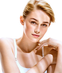 Beauty portrait of young woman model. Photo of attractive blonde girl on white background. Youth and skin care concept