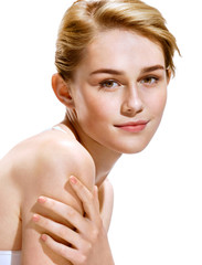 Image with beautiful blonde girl on white background. Close-up of an attractive girl of European appearance. Skin care concept