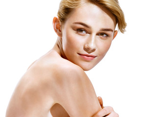 Beautiful sensual blonde girl. Close-up of an attractive girl of European appearance on white background. Skin care concept
