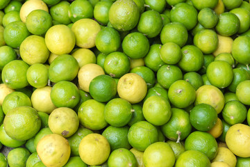Stack of limes on display at farmers market