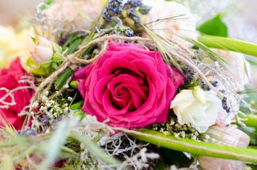 Pink rose on wedding day