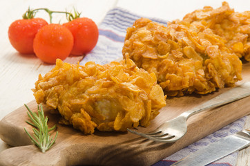 fried chicken thighs coated with corn flakes
