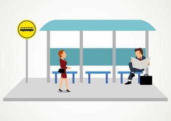 Woman and man waiting at the bus stop