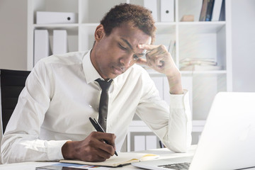 Upset man working on project