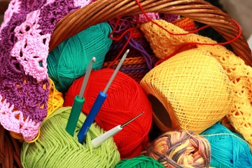 Basket with colorful balls of yarn and hooks