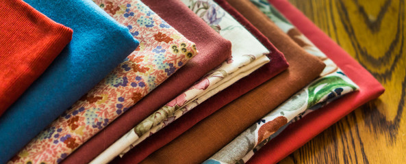 stash of fabrics for fall sewing projects 