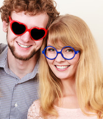 Happy couple man and woman in glasses.