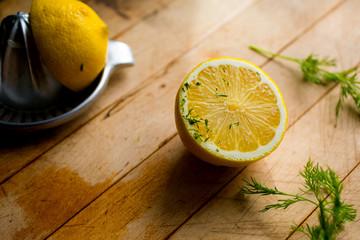 halved lemon on wooden surface