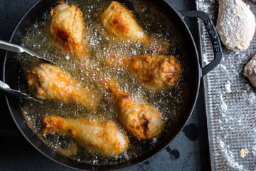Chicken frying in pan