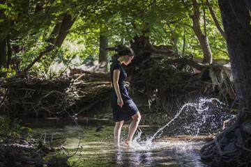Teenage girl splashing water