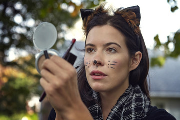 Woman doing cat make-up