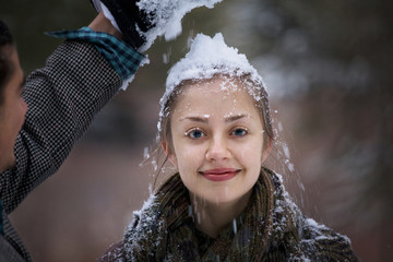 Woman with pile of snow on head