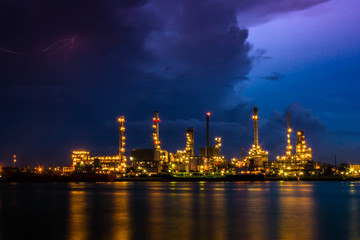 Oil refinery at twilight , Chao Phraya river, Thailand