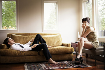 Unhappy young couple in living room