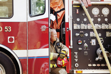 Firefighter sitting in fire engine