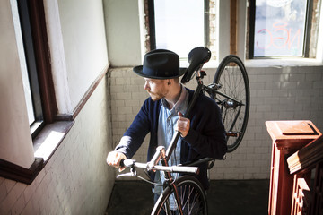 Man walking up stairs with bicycle