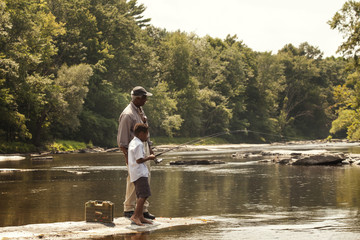 Senior man and boy (6-7) fishing together