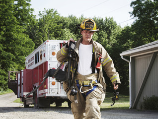 Firefighter walking with oxygen tank