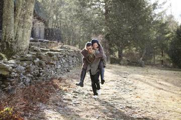 Young couple piggyback riding