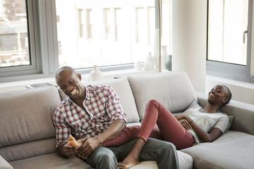 Smiling couple enjoying at home