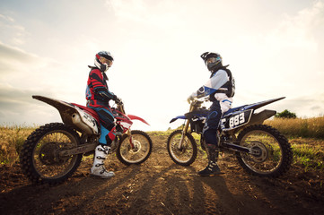 Two Motocross riders looking back